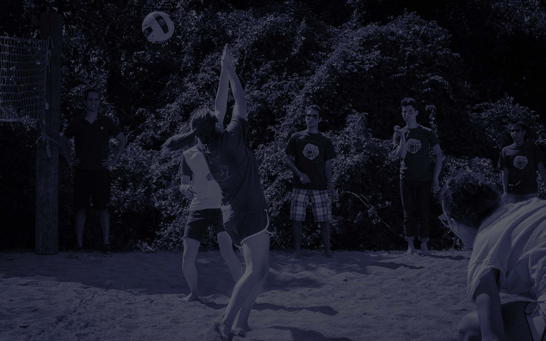 MCO playing volleyball