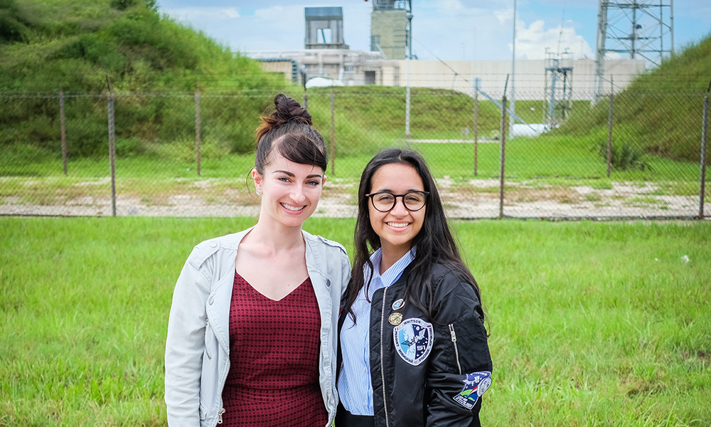 Tessa (left) and Alia in front of the launch pad